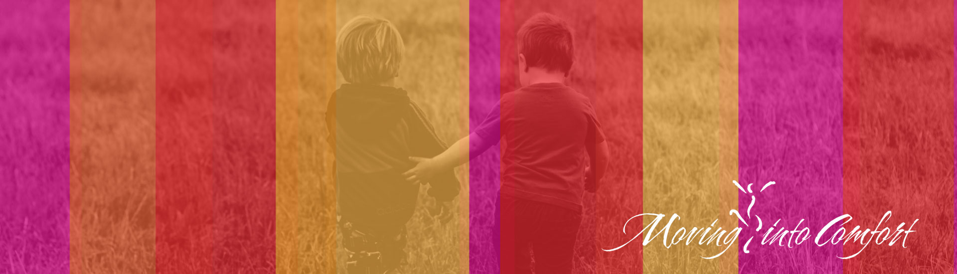 Two children walking in field with arms around each other